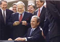 President Bush signs bill naming the federal courthouse for Moakley.