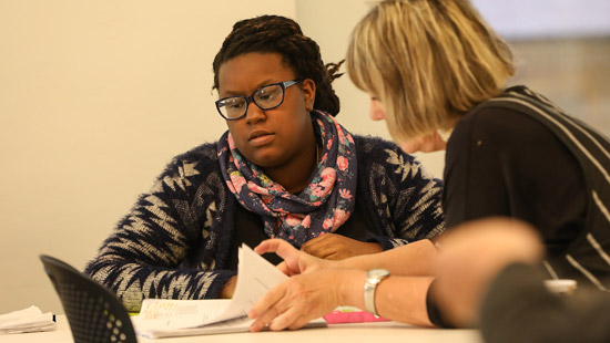 Student working with professor in playwriting class