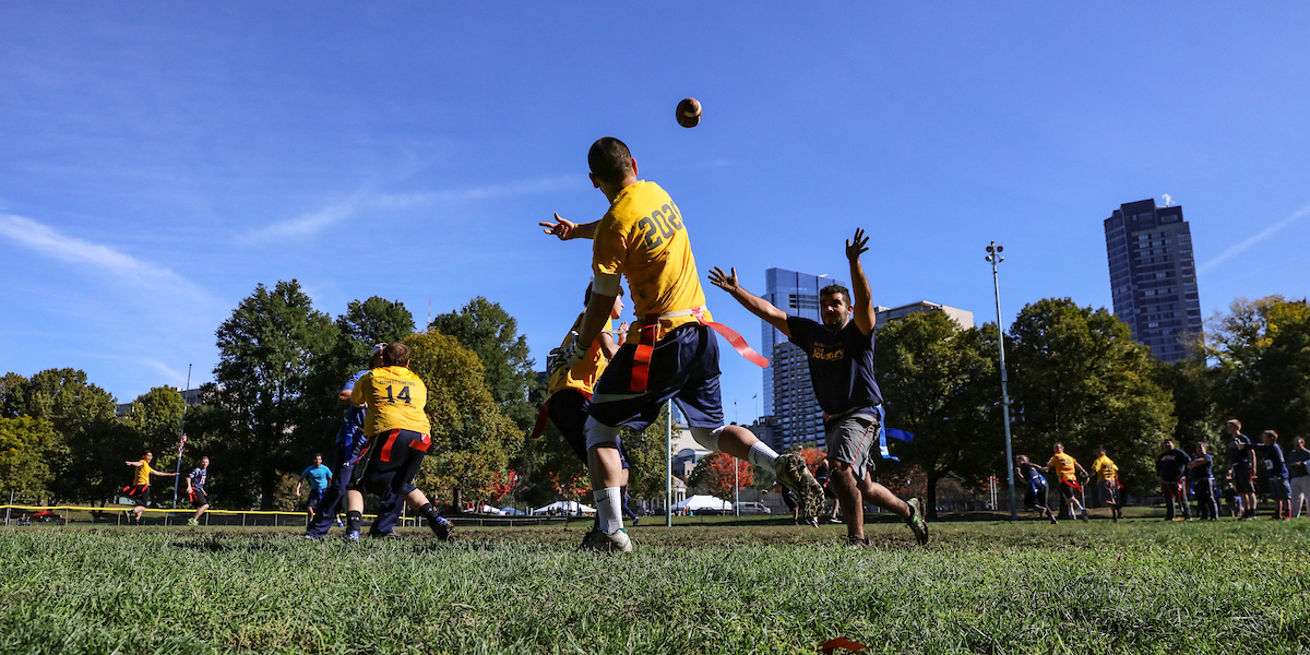 Dan Redznak throws a pass during a football game on the Boston Common.