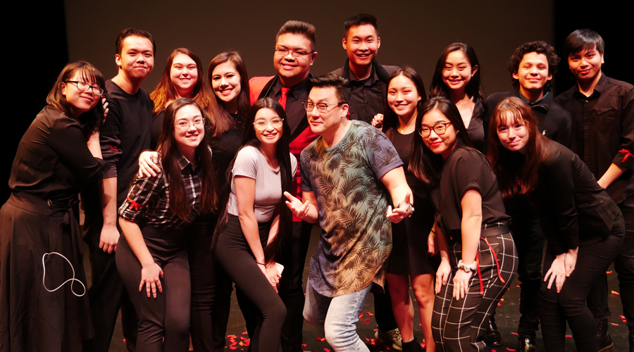 Suffolk student Brandon poses with the Asian American Student Association at the Modern Theatre.