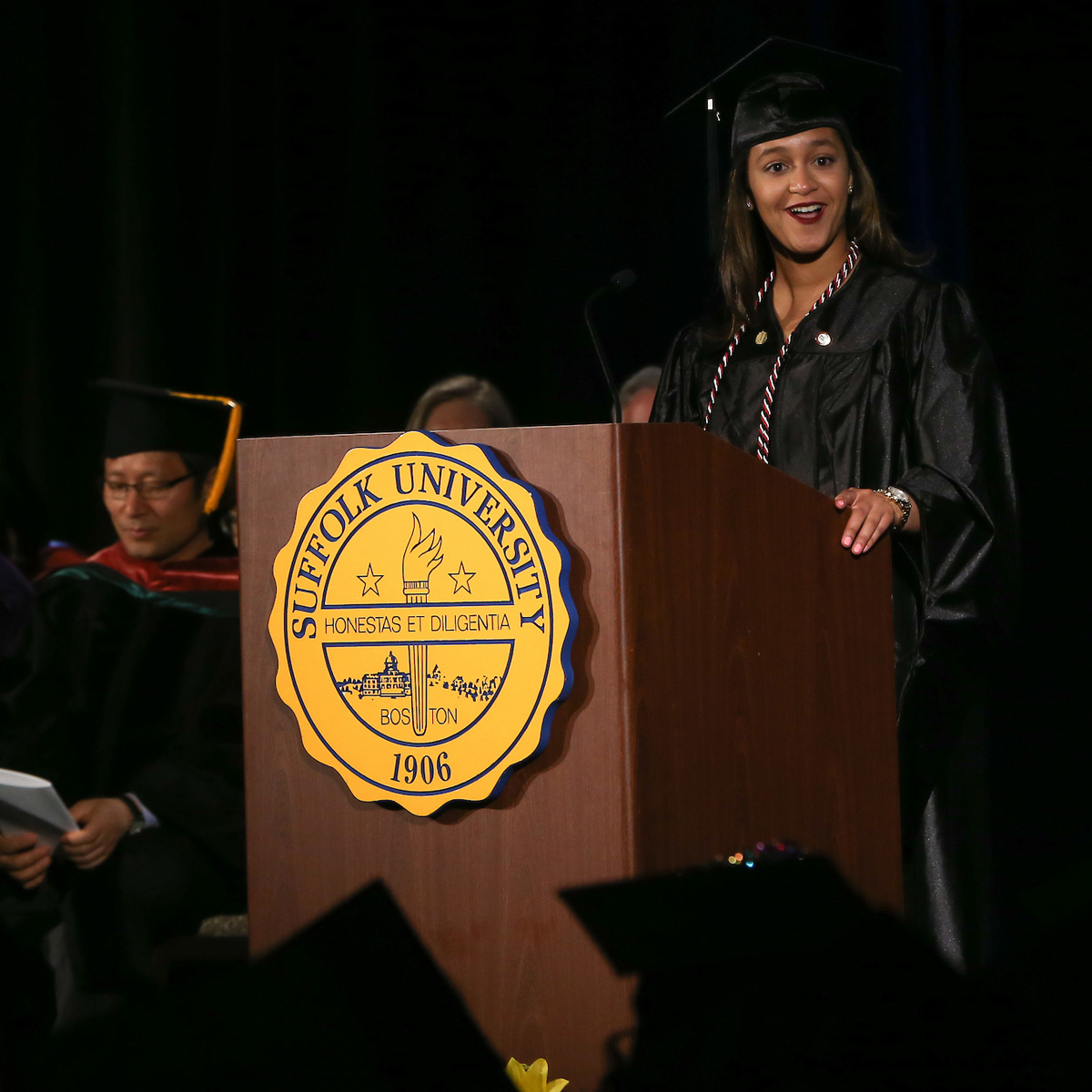 Elainy Mata giving a speech at her graduate degree Commencement ceremony.