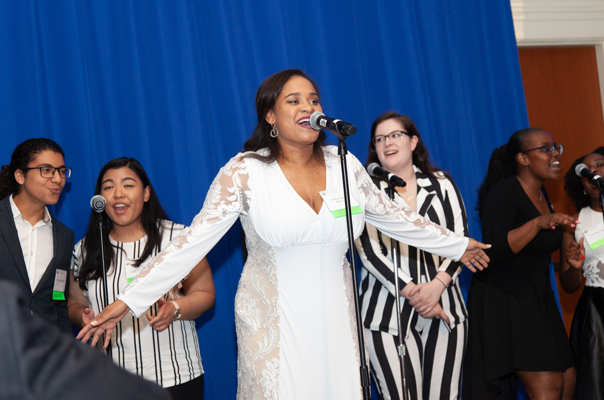 Jo'lise hits a note during a performance by her a capella group Soulfully Versed at Commencement Eve Dinner.