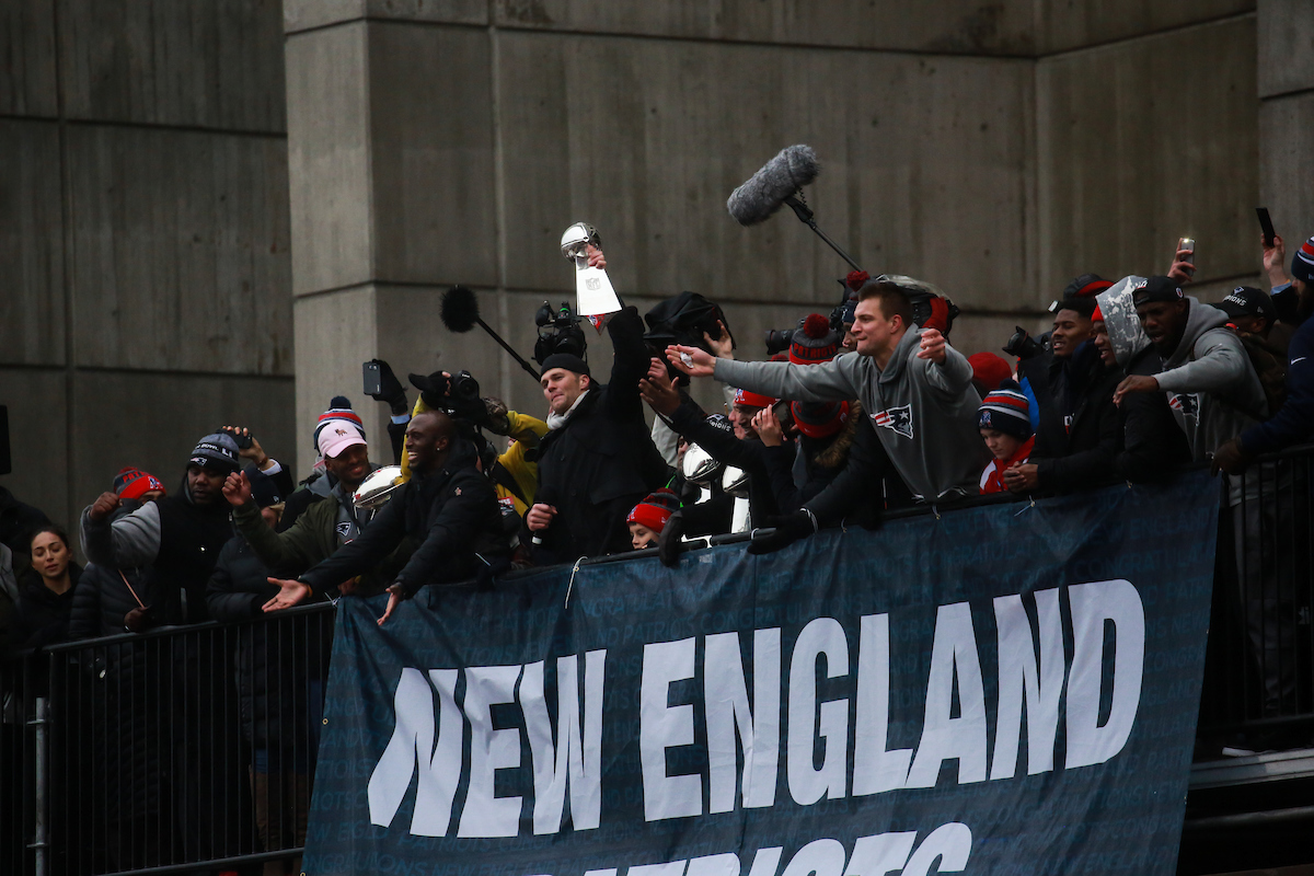 Quarterback Tom Brady and tight end Rob Gronkowski show off the Super Bowl trophy to the crowd following the Patriots Super Bowl victory parade.