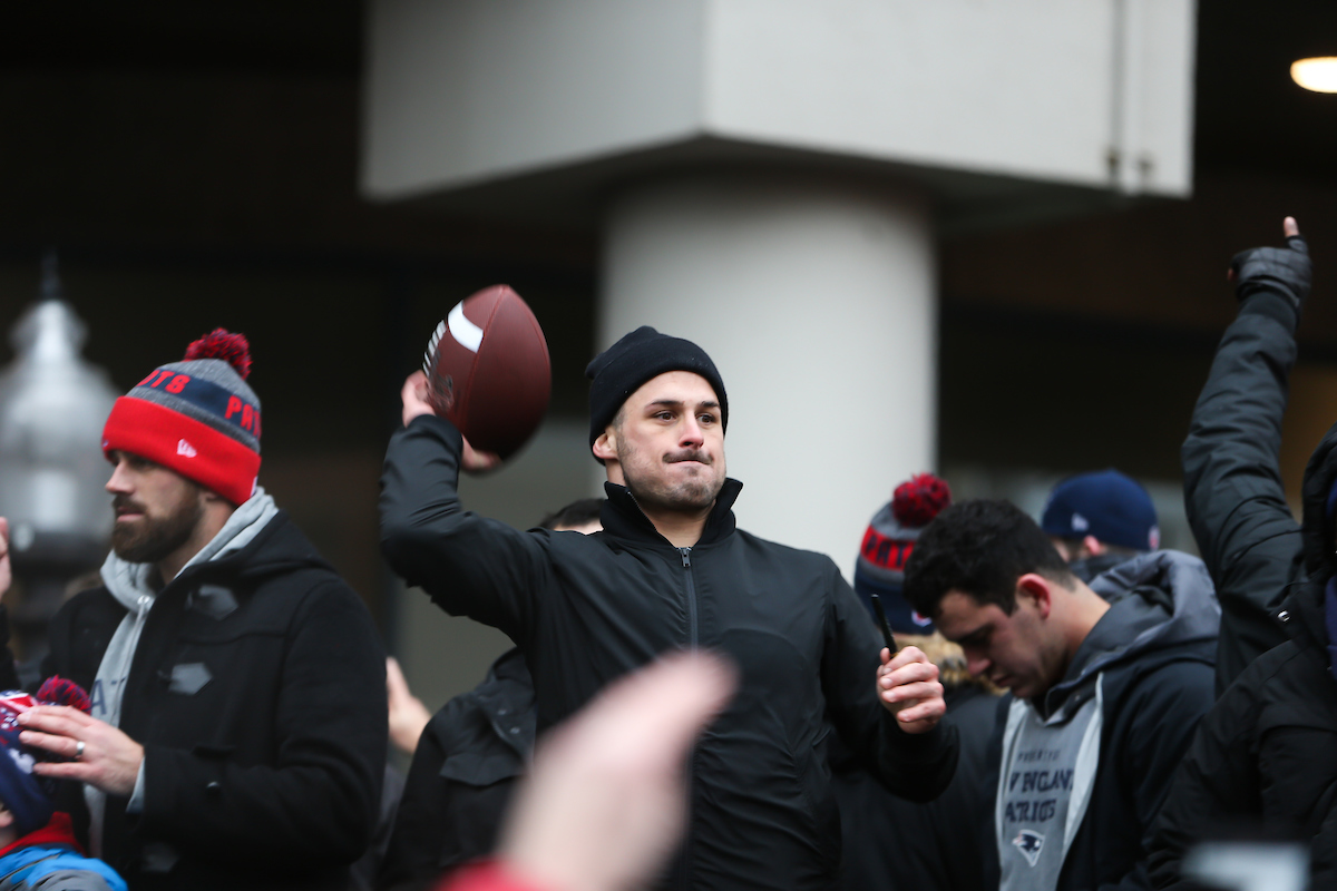 Wide receiver Danny Amendola prepares to throw a football into the crowds along Tremont Street during the Patriots Super Bowl victory parade.