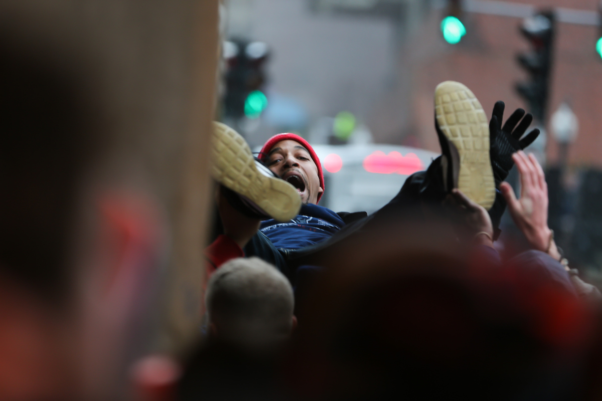 The New England Patriots Super Bowl victory parade draws thousands of spectators to Suffolk's downtown Boston campus.