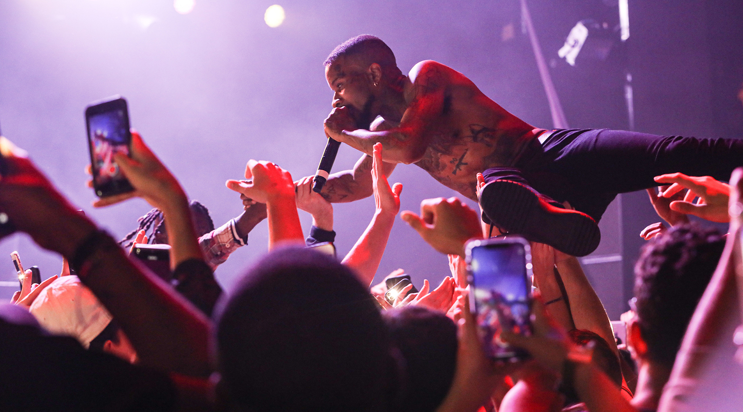 Rapper Tory Lanez crowdsurfing during his performance at Suffolk's Fall concert