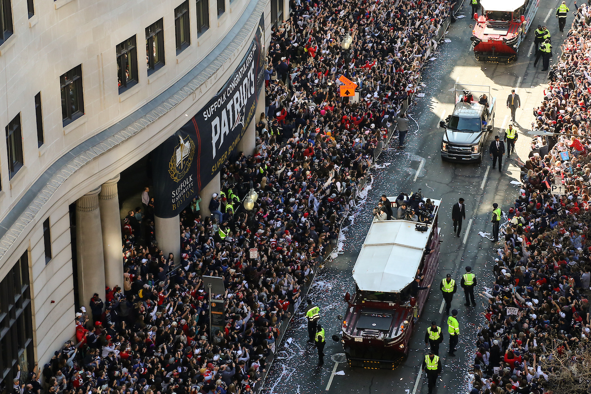 Aerial shot of Duck Boats driving by Suffolk University.