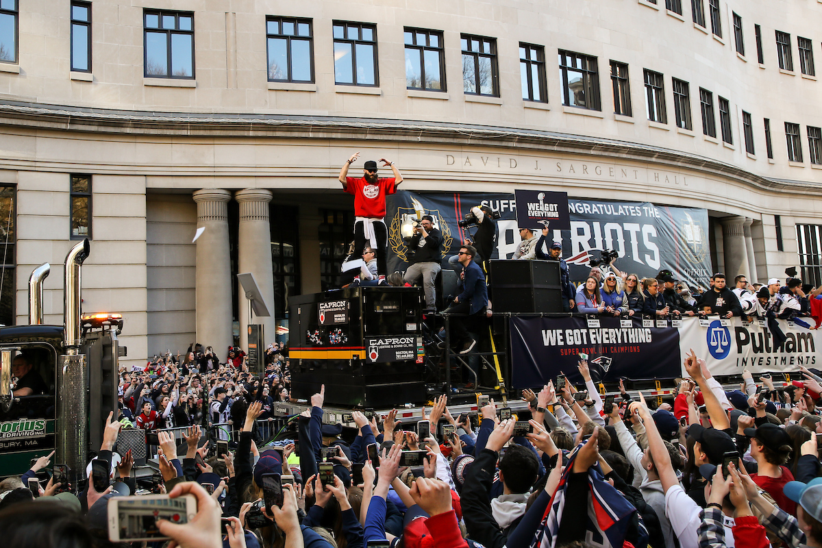 Edelman pumping up the crowd in front of the Suffolk building at the Patriots Parade.