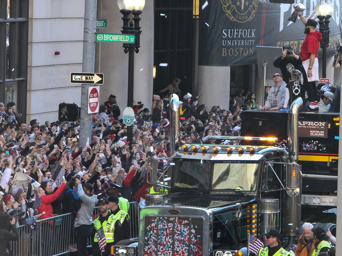 Julian Edelman on the Duck Boat, pointing out to the Suffolk crowd at the parade.