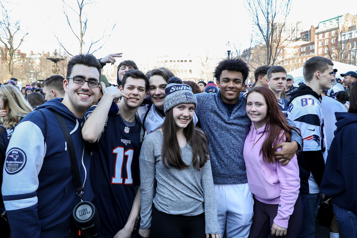 Suffolk students outside of Park Street stop, getting ready for Patriots parade to roll by.