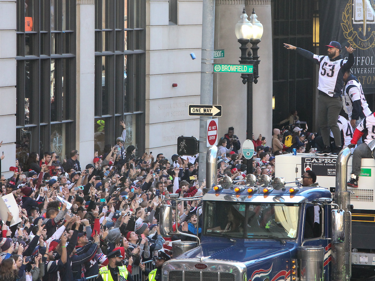 Van Noy pointing to Suffolk students as he's driving through campus during Super Bowl parade.