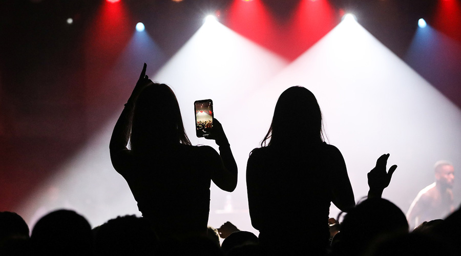 Suffolk students take pictures at the Tory Lanez concert