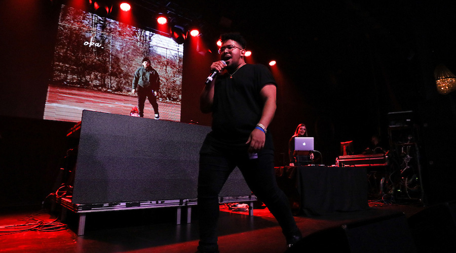 Suffolk student rapping at university concert