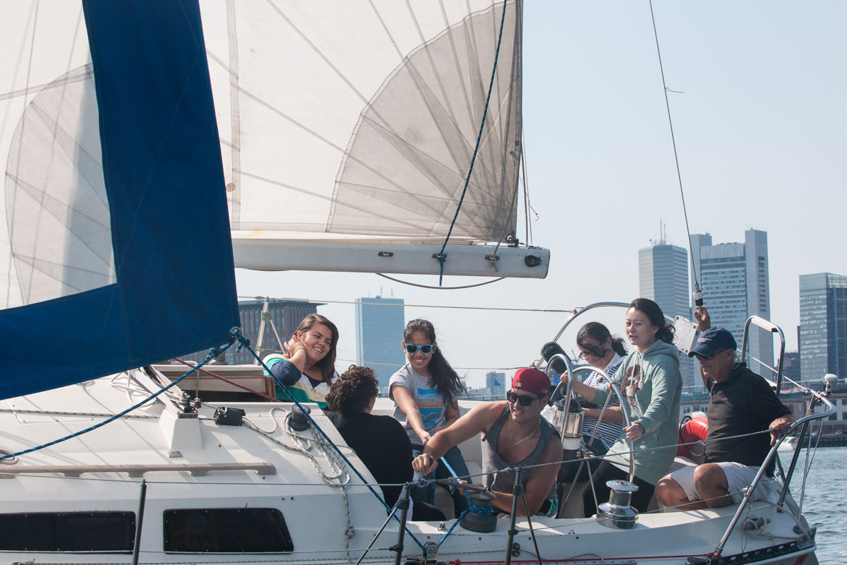 Suffolk Journey students sailing a boat in Boston Harbor in 2012.