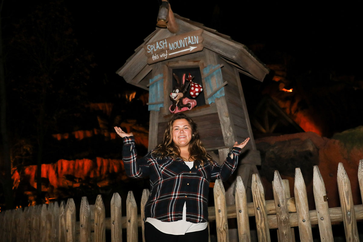 Suffolk Journey student alumna Jess DiLorenzo posing in front of Splash Mountain, the Disney ride for which she now works.