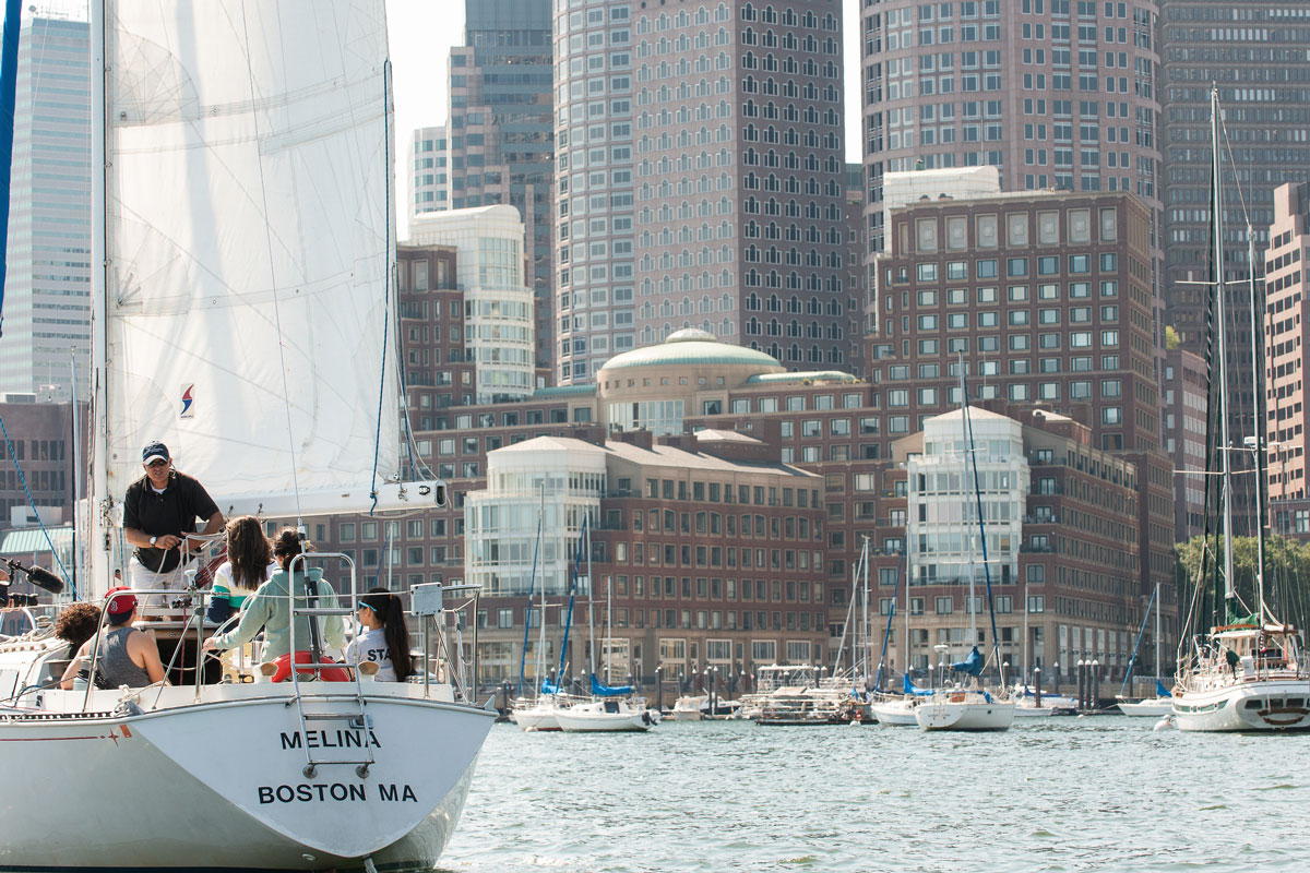Suffolk Journey students listening to the sailing instructor during their lesson on the Boston Harbor in 2012.