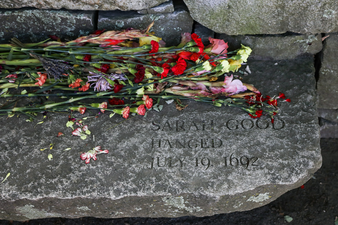 Flowers next to Sarah Good Hanged's tombstone