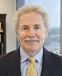 Headshot of Suffolk Law Alumnus Kevin Fitzgerald, white man with curly hair