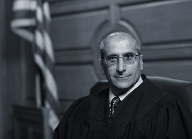 Justice Gaziano sitting in his judges robes