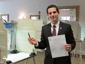 James V. DeAmicis holds a voting ballot