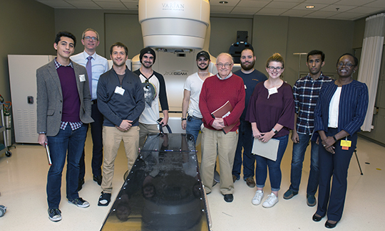 Mario Rojas '18, Dr. David Gierga, Paul Johnson '18, Jackson Nolan '19, Erick Bergstrom '19, Professor Walter Johnson, Jack Thomas '19, Molly McDonough '21, Allen Alfadhel '18, and Jacky Nyamwanda at Massachusetts General Hospital's Department of Radiation Oncology
