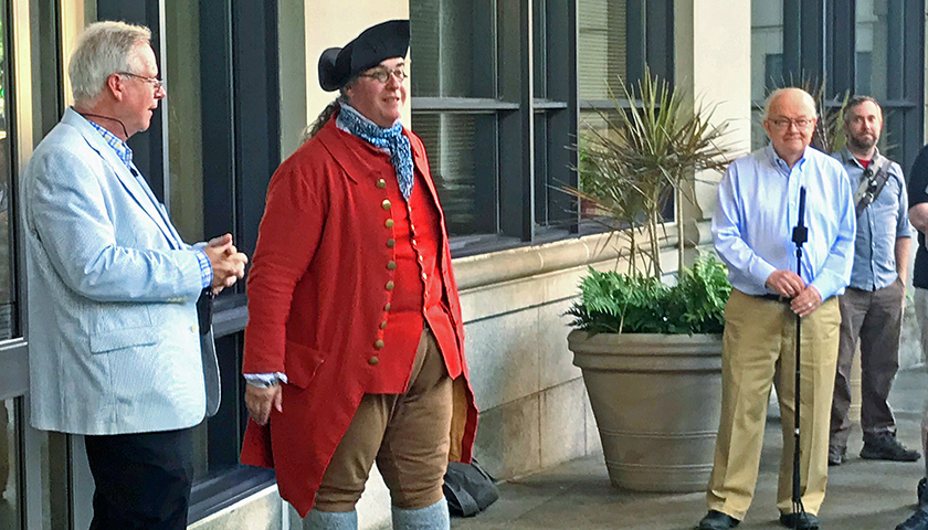 Professor Robert Allison and Walter Johnson, both in modern-day clothing, with a Colonial-era reenactor in front of Sargent Hall. Photo by Lisa Celovsky