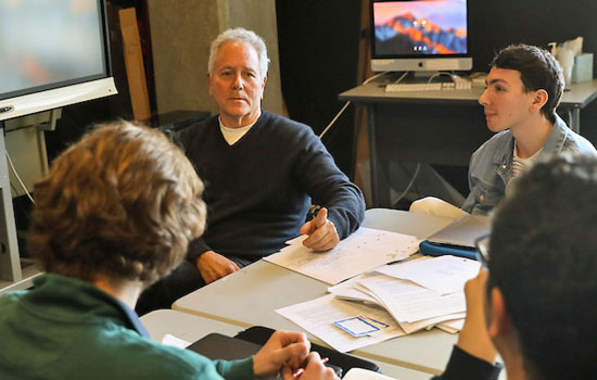 David Hoberman offers one-on-one guidance during campus screenwriting workshop.