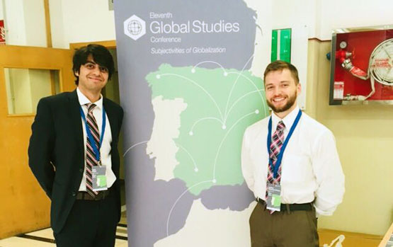Joshua Weissman LaFrance and Yash Patel in Granada, Spain to present their research.