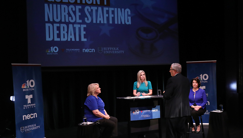 Panelists discuss the 2018 Massachusetts Question 1 ballot initiative on hospital nurses' staffing at Suffolk University