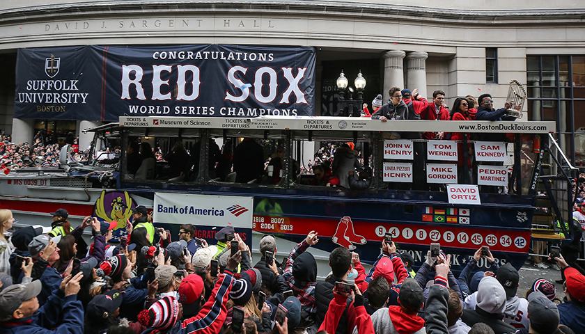 Duck boat with Red Sox veteran players passes by cheering fans outside Suffolk's Sargent Hall