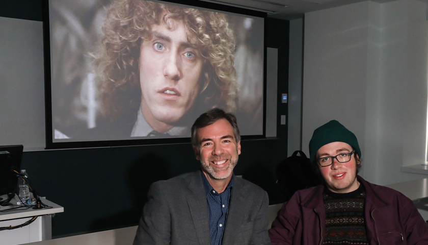 The face of The Who's Roger Daltrey is projected on a screen behind  Quentin Miller and Caleb Elfland