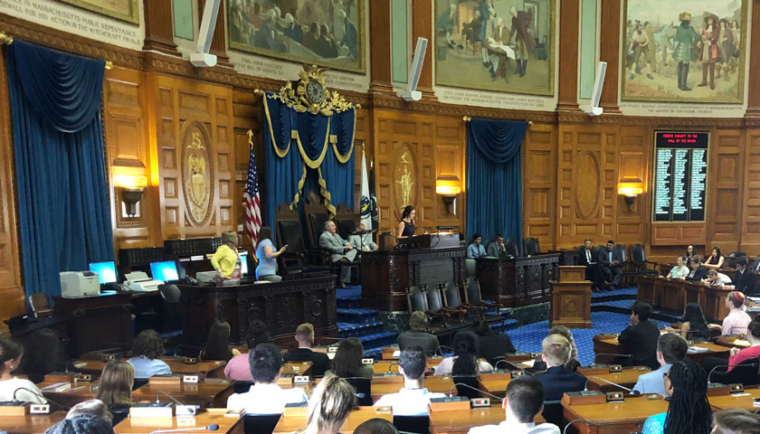Anna Duffy introduces the speaker in the MA House of Representatives