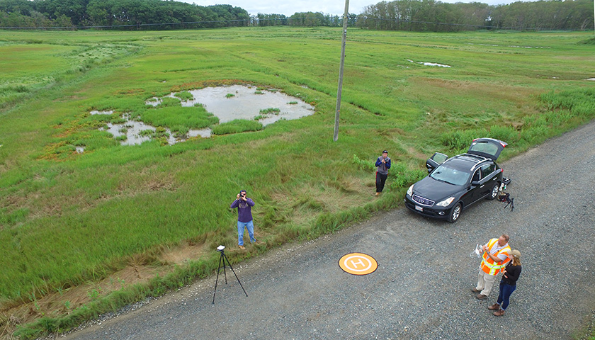 Research team on the ground looks tiny in photo shot from drone
