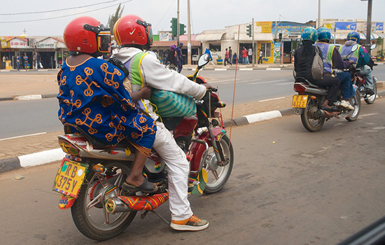 Two motorbikes, each carrying two people