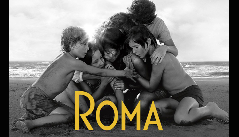 Poster for Roma film shows family huddled on beach