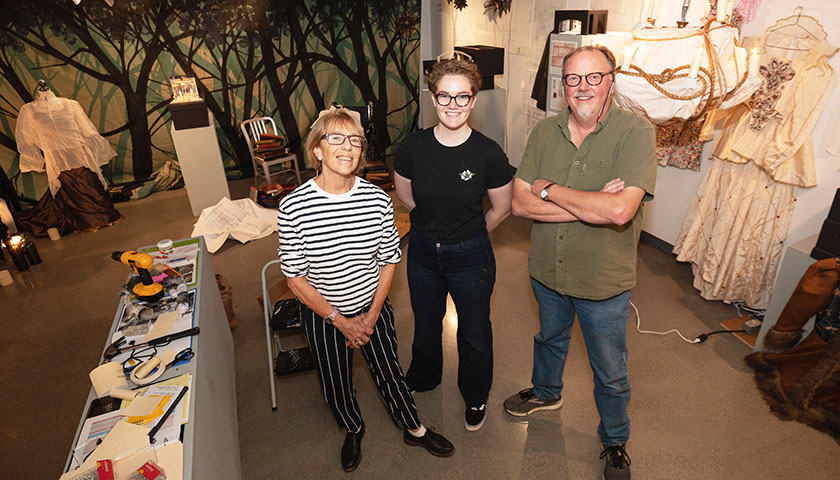 Deborah Davidson, Micaleen Rogers and Richard Chambers pose in the middle of the gallery during exhibit installation