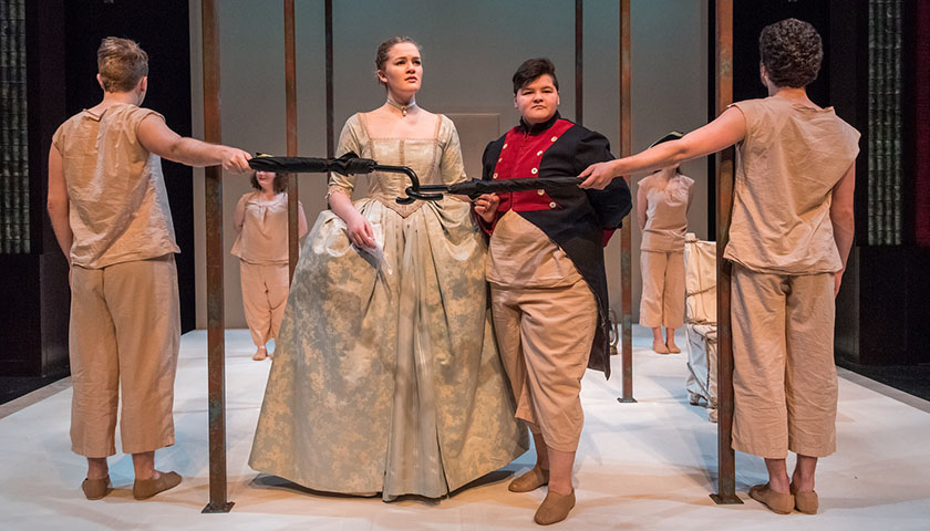 Woman in a gown and man in military-style uniform of the past