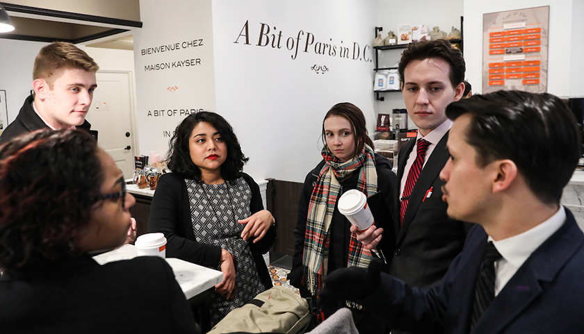 Discussion continues as students stop at coffee shop