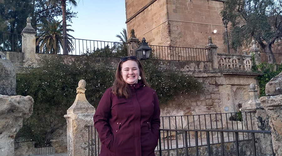 Mikayla Hopkins in front of castle turret in Cordoba