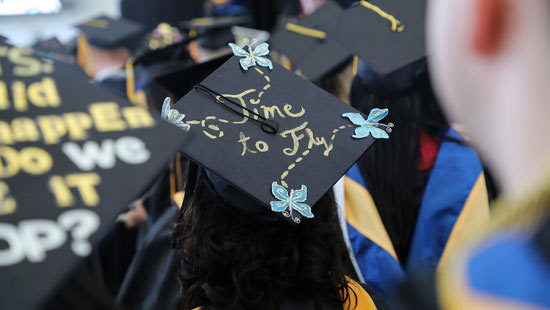 Students mortarboards decorated with personal messages
